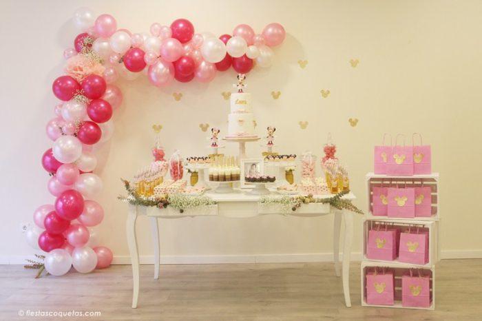 Fiesta Minnie Mouse en rosa y dorado